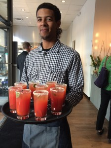 James offers guests blood orange and serrano pepper mocktails before the Cafe Momentum baguette cutting