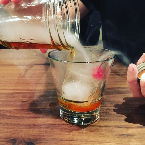 A smoked old fashioned at Lakewood Smokehouse. Photo by foodbitch