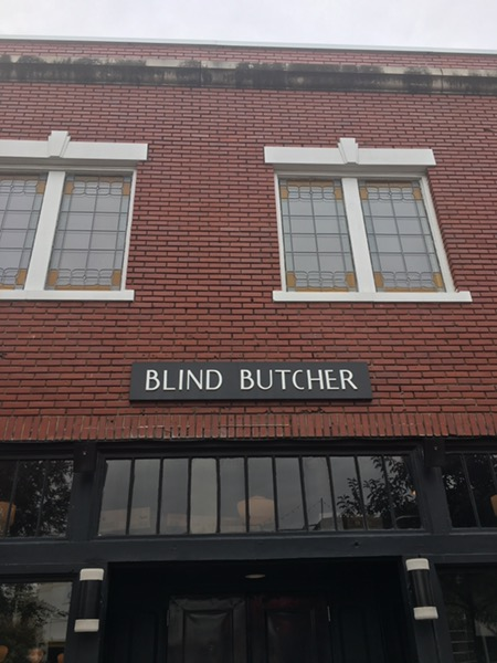 the blind butcher signage