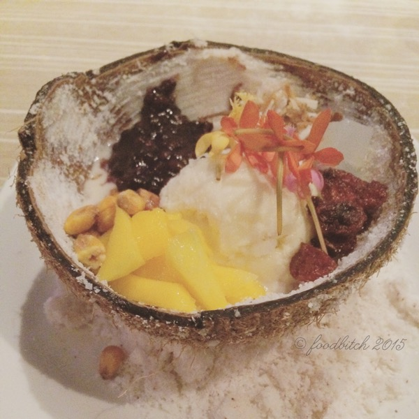 DESSERT COURSE: house-made coconut ice cream, padanouse forbidden rice, dried strawberries from Dalat, corn nuts, coconut gelee, longan and toasted coconut, served in a coconut shell atop coconut dust. Wow.